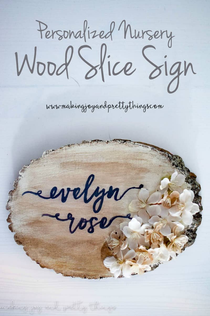 Add a bit of farmhouse decor to your girl nursery decor with an easy DIY craft personalized nursery wood slice sign