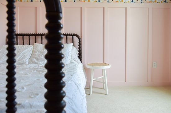 Looking for DIY nightstand ideas? I tried my hand at DIY cane projects with a DIY cane nightstand for Evie's toddler girl room! I used a stool from Target, some spray paint, and cane to make a DIY nightstand. It's the perfect addition to a little girl's room if you're looking for girl room ideas. The DIY cane nightstand was an easy DIY that adds tons of style and function to her girly room. #cane #canefurniture #diyprojects #diycanenightstand